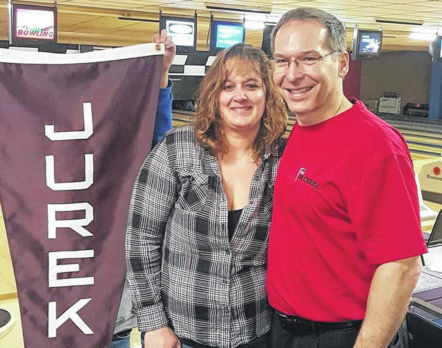 Professional Bowlers Association senior bowler Jack Jurek, right, and Laurie Rinehart from Victory Lanes pose for a photo following a PBA event at the Galion bowling center. Jurek has been a participant in previous editions of the PBA Sherry Bodkins Women's Health Awareness Memorial Central Open. This year's event is scheduled for April 2-4 at Victory Lanes.