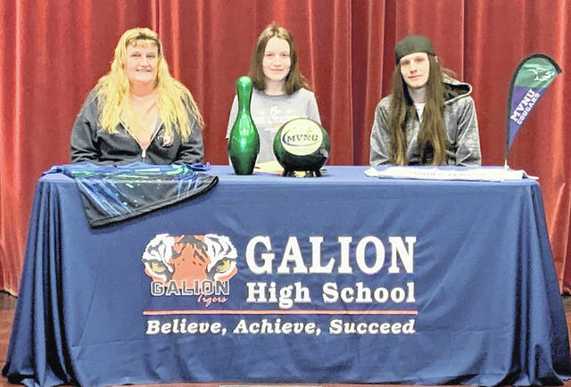 Galion High School senior Shelena Wilcox, center, has signed a letter of intent to attend Mount Vernon Nazarene University in the fall. She is joining the Cougars bowling program. Wilcox plans to major in biology.
