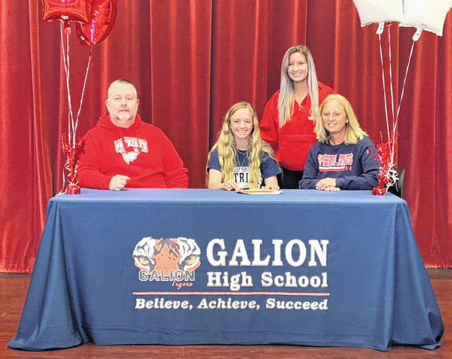 Galion high school senior Kaisey Speck, seated center, has signed a national letter of intent to attend the University of the Cumberlands in Williamsburg, Kentucky. She will swim for the Patriots team that has won nine consecutive Mid-South Conference championships and finished the 2020-2021 season ranked No. 2 in the NAIA. Speck was joined by her parents, Chad and Brooke, and her sister, Kennedy, at the signing ceremony.