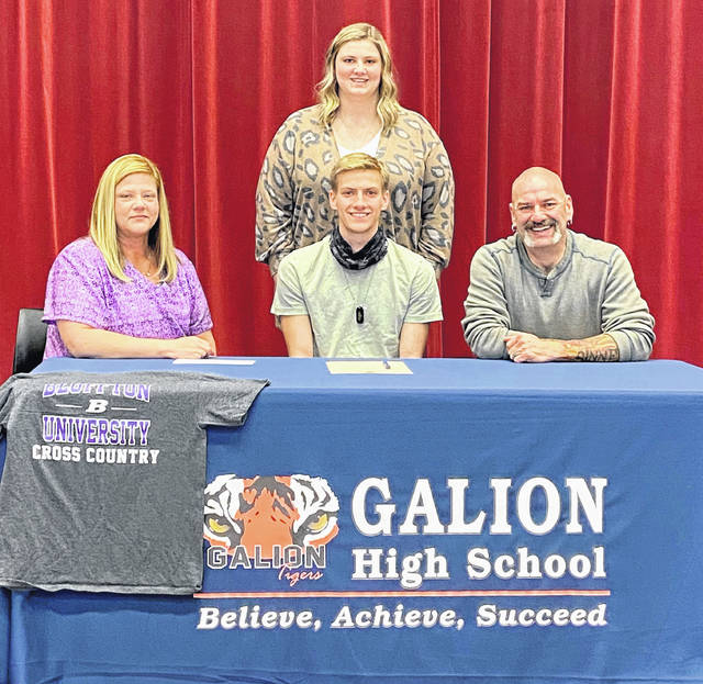 Galion High School distance runner Braeden Horn, seated center, has signed a national letter of intent to attend Bluffton University in Bluffton, Ohio. He plans to continue his career in cross country and track and field there. Horn is shown with his family at his signing ceremony: mother, LeeAnn; father, Todd; and sister, Taylor.