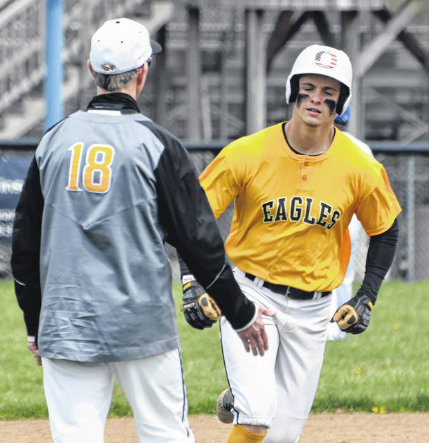 Cade Hamilton, right, rounds the bases after hitting a 2-run home run for Colonel Crawford in the first inning against Crestline on Saturday, April 17, 2021, at Gates Brown Field. The Eagles went on to win 10-4 to improve their record to 12-0.