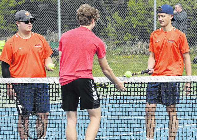 Jaime Hollis, left, and Zack Grimes, right, first doubles