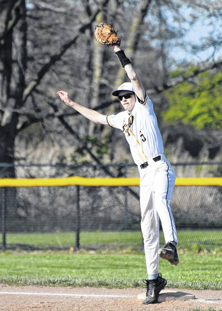 Colonel Crawford's Brennan Hamilton stretches to make a play during the Eagles game against Seneca East on Monday, April 26, 2021, at Marion Althouse Field in North Robinson. The Eagles won 5-4 to improve to 17-0.