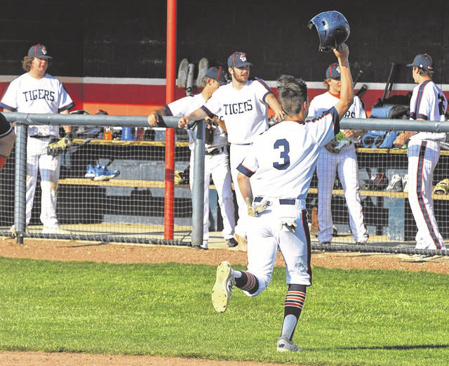 Galion's Hudson Miller celebrates after scoring a run during the Tigers 10-5 victory over Ontario on Tuesday, April 27, 2021, at Heise Park.
