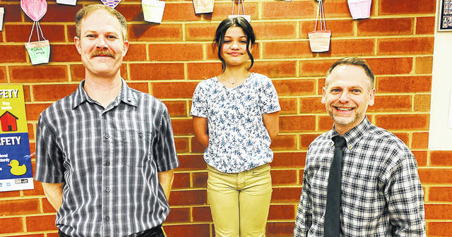 Galion fifth-grade student Bella Alberty, center, was selected as a member of the American Automobile Association (AAA) Safety Patrol Hall of Fame for the 2020-2021 school year. She was nominated by Safety Patrol Advisor Adam Lehman, left, and Galion Intermediate School Principal Alex Sharick, right.