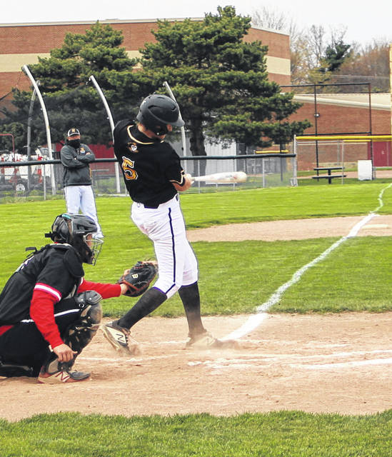 Northmor's Preston Harbolt swings at a Cardington pitch during his team's 11-3 win over the Pirates Tuesday afternoon.