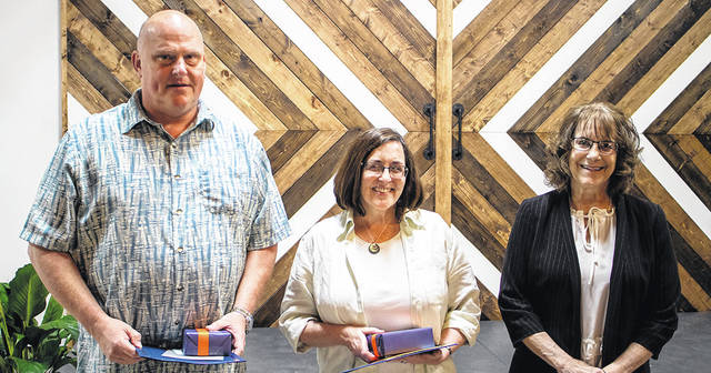 Galion City Schools staff members, left to right, Dave Rinehart, Sara Palmer, Stephanie Kiger, and Travis Watson (not pictured) were recognized as retirees during the district's annual staff recognition event on May 27. This year's retirees represent more than 120 years of educational experience as a group.