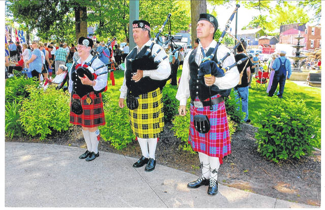 Bagpipe players Ginny Cameron, Gary McCutcheon, and Mark Hedge, shown performing during a community event, will present 30-minite concerts at sunset on 11 Sunday evenings this summer at the lakeside at Ariel-Foundation Park in Mount Vernon.