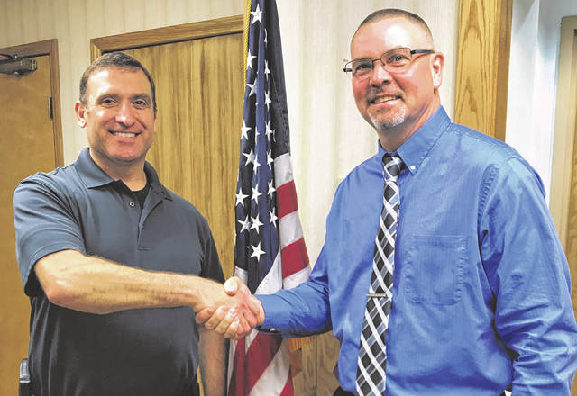 Retiring Galion Police Chief Brian Saterfield, right, shakes hands with new Chief Marc Rodriguez during a reception in Saterfield's honor on Friday, May 7, 2021, at Galion City Hall. Saterfield has retired after 17 years leading the Galion Police Department. Rodriguez was sworn in on Friday.