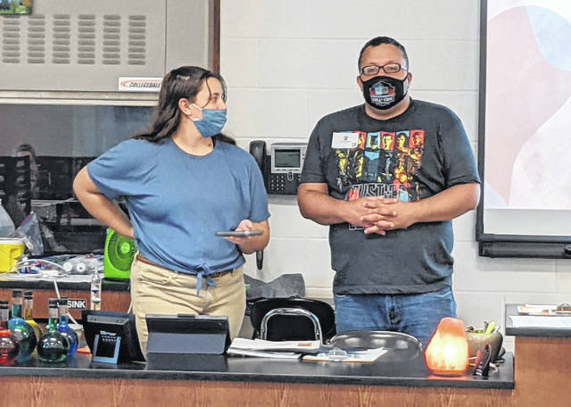Galion High School sophomore Julia Conner, left, and Joe Hopkins teach about the chemistry of Autism for Conner's school chemistry project. Hopkins, who has been diagnosed with Autism, is a client of the Marion County Board of DD and Residential Housing Association of Marion.
