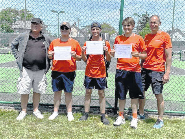 Members of the Galion High School boys tennis team pose for a photo following the opening round of the Division II district tournament on Wednesday, May 19, 2021, in Port Clinton. Pictured from left to right are head coach Tom Pawsey, doubles players Jamie Hollis and Zach Grimes, singles player Matt Gimble, and assistant coach Terry Gribble.