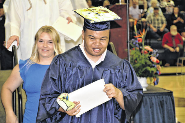 Galion High School graduate Damontae A. Adams leaves the stage after receiving his diploma during the 2021 commencement ceremony on Sunday, May 23, 2021. He was one of 94 students who graduated on Sunday.