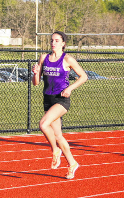 Winning four events and helping the Mount Gilead Lady Indians win a KMAC track and field title was Allison Johnson. She is pictured running the 400.