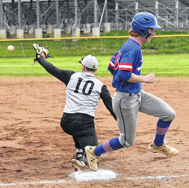 Highland's Blake Jodrey, right, hustles to beat a throw to first base during the Fighting Scots 6-3 win over Northmor on Thursday, May 6, 2021, at Northmor High School. Golden Knights first baseman Preston Harbolt stretches to make the play on the ball.