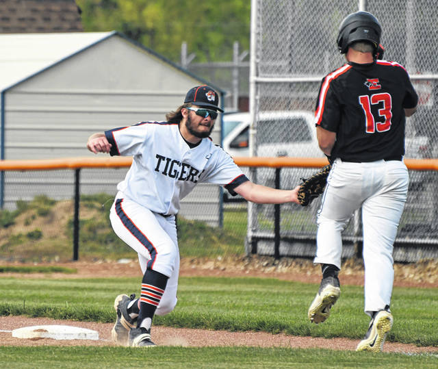 Galion first baseman Brody Sysmick tags out Elida's Carter Harsh during the Division II sectional championship game on Friday, May 21, 2021, at Heise Park in Galion. Elida prevailed 8-6 to advance to the district tournament at Bluffton University.
