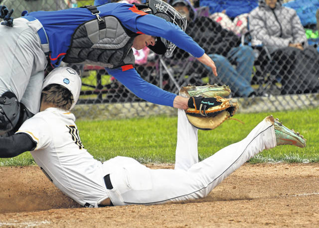 Colonel Crawford's Cade Hamilton and Edison's Dominic Dymond collide during a play at home plate in the third inning of the Division III district chamoionship game on Saturday, May 29, 2021, at Shelby High School. Hamilton was safe on the play. Edison rallied from a 3-0 deficit to defeat the Eagles 6-5 in eight innings.
