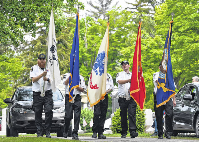 Veterans bearing the flags of the various branches of the United States military lead the way to the Veterans Memorial at Fairview Cemetery in Galion where the annual Memorial Day ceremony was held on Monday, May 31, 2021. Local residents lined the parade route and gathered at Fairview to honor the memory of military personnel who gave their lives in service to the country.