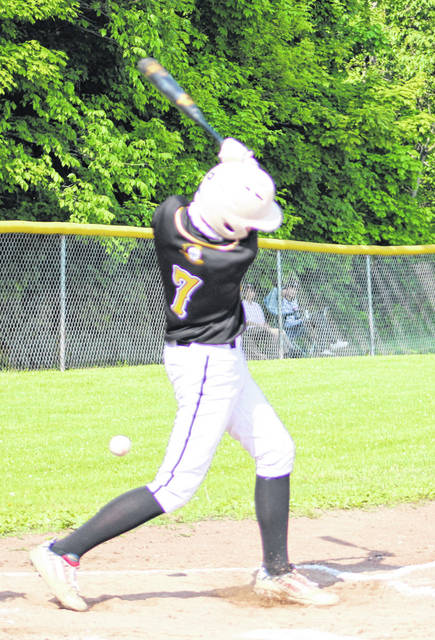 Grant Bentley fouls off a pitch against Columbus Academy Monday. The Golden Knight freshman picked off three Academy base-runners from his catcher position.