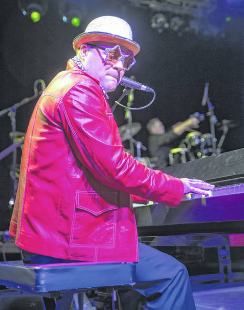 Elton John tribute artist Ronnie Smith is a member of the band Face-2-Face.