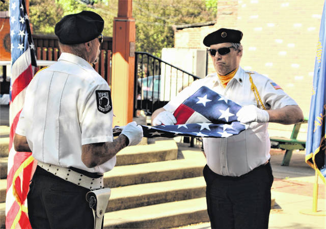 Members of American Legion Post 243 conduct a trifold flag-folding ceremony during the Flag Day celebration on Monday, June 14, 2021, on the Square in Uptowne Galion. The Galion United Lions Club organized the event along with local veterans organizations from the Galion area.