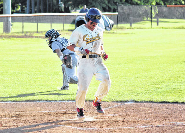 Avery Fisher crosses home plate to score the lone run of the game for the Galion Graders against the Sandusky Ice Haulers on Wednesday, June 16, 2021, at Heise Park. Sandusky rolled past Galion, 15-1.
