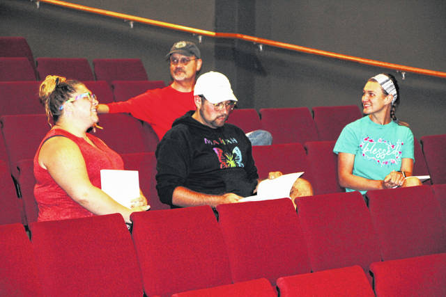"""Cast members of the Galion Community Theatre's production of the musical """"Godspell"""" chat while they wait for the start of the first script read-through on Wednesday, June 16, 2021, at the theater. The show will be presented July 23-25 with two evening performances at the theater and a matinee on July 25 at the Heise Park band shell. For ticket information, go to www.galiontheatre.org."""