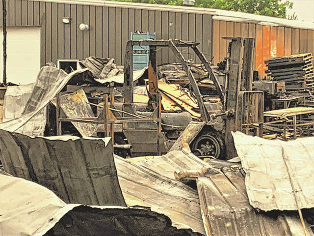 A forklift rests among the charred remains of a building at Flick Packaging Co., 340 South Columbus Street in Galion. Fire gutted the building that housed the company's cutting department on Thursday, June 24, 2021. Galion Fire Department officials said the building is a total loss. The investigtion into the cause of the fire continues.