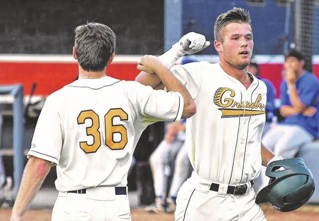 Galion's Jay Luikart, right, receives congratulations from teammate Ben Sinins (36) following a solo home run in the fifth inning of the Graders 9-3 loss to the Lima Locos on Saturday, June 19, 2021, at Heise Park. Luikart finished with two hits and scored two runs.