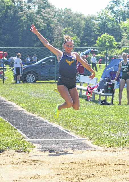 Colonel Crawford's Katie Ruffener flies through the air on her way to a second-place finish in the long jump.