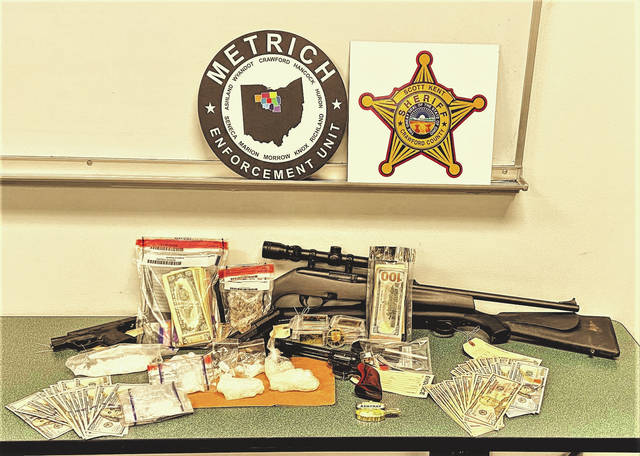 Law enforcement authorities arrested two people and seized methamphetamine, firearms, and cash during the raid of a residence on Wednesday, July 7 in Crestline.