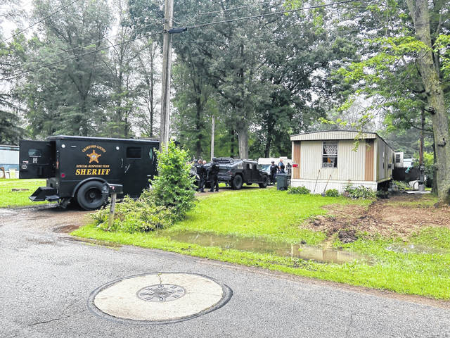 Crawford County law enforcement agents arrested two people and seized drugs and cash following the early morning raid on Wednesday, July 14 of a residence at 476 Fifth Avenue in Galion.