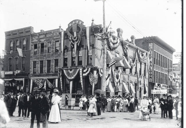 This photo shows the first Citizens National Bank on the Square in Galion. The corner is decorated for a Galion celebration, probably a summer Free Fair.