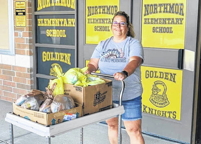 April Bugbee, Northmor Schools cook, brings meals to be delivered Monday, Aug. 2. It is part of the school's Seamless Summer Option food program.