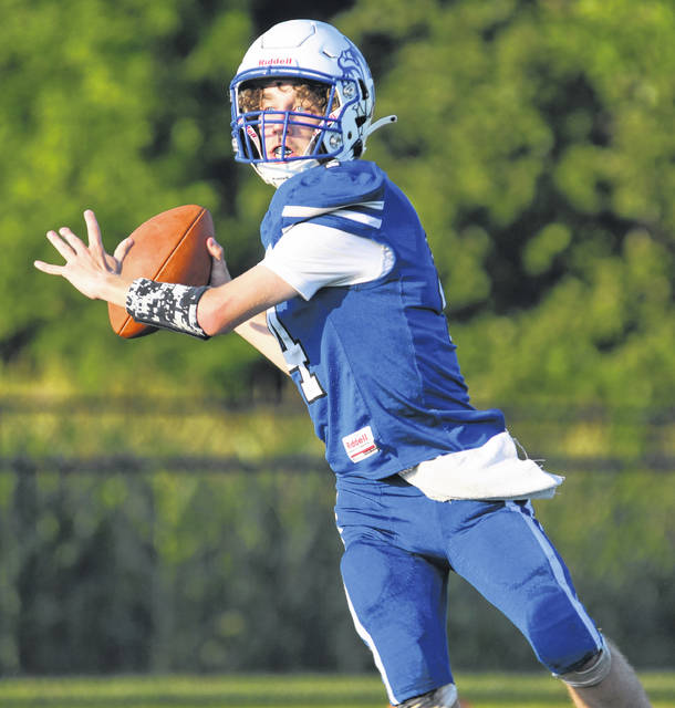 Crestline quarterback Trevor Shade prepares to sling a pass downfield against Buckeye Central in the season opening game for both programs on Friday, Aug. 20, 2021, at Hutson Stadium. The Bucks prevailed, 45-12. Shade completed completed 19-of-29 passes for 175 yards, two touchdowns, and one interception.
