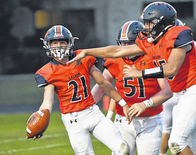 Galion's Hunter Miniard (21) receives congratulations from teammates after recovering a fumble in the first quarter of the Tigers game against Carey on Friday, Aug. 27, 2021, at Unckrich Stadium. Carey rallied from a 21-7 halftime deficit to defeat Galion 35-21.