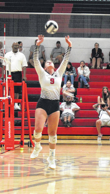 Cardington setter Jadine Mills sends the ball to one of her team's hitters in their 3-1 win over Northmor on Tuesday.