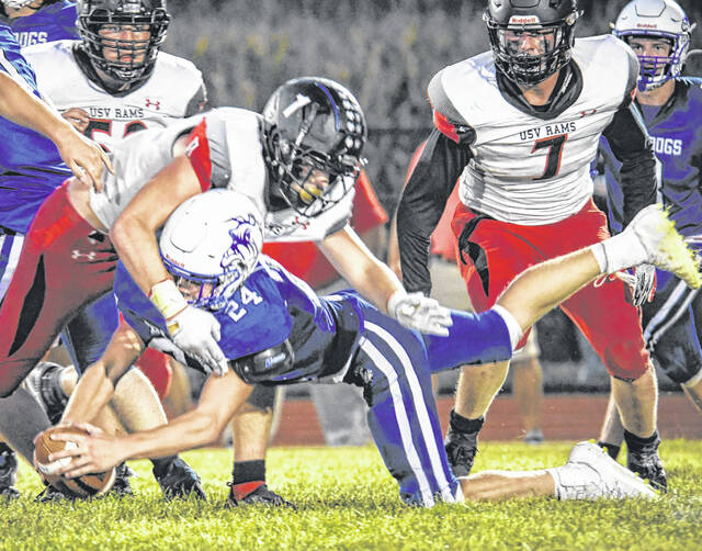 Crestline running back Josh Hall dives for yardage against Upper Scioto Valley during a Northwest Central Conference game on Friday, Sept. 17, 2021, at Hutson Stadium. The Rams defeated the Bulldogs, 42-8.