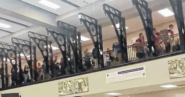"""Galion High School students follow the GHS band through the hallway to the cafetorium for one of the new """"Spirit Friday"""" assemblies held each Friday in the building."""