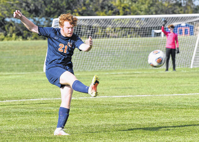 Galion's Kennan Walker drives a free kick to the goal for the Tigers' lone score against Mansfield Christian on Tuesday, Sept. 14, 2021. The Flames defeated the Tigers 2-1.