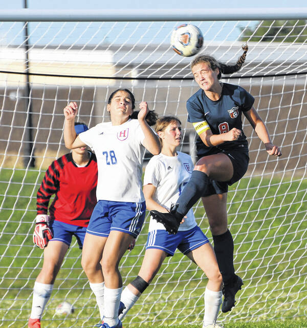 Galion's Adriana Zeger (right) wins a header against Highland's Sophia Hinkle (28) and Lily McElroy during a non-conference soccer match on Wednesday, Sept. 15, 2021. The Lady Scots prevailed 8-1.