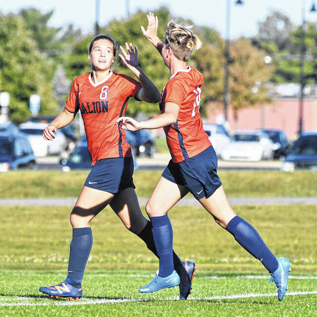 Galion senior Adriana Zeger (8) celebrates the first of her three goals in Galion's 3-1 win over St. Peter's on Wednesday, Sept. 29, 2021. Teammate Tamara Shaw gives Zeger a high five.