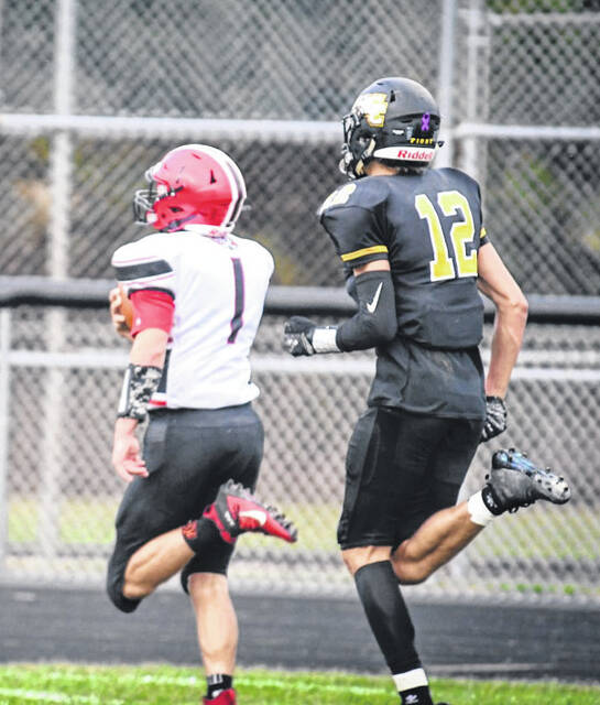 Cardington's Ayden Plowman heads to the end zone in the first quarter of his team's game at Colonel Crawford Friday.