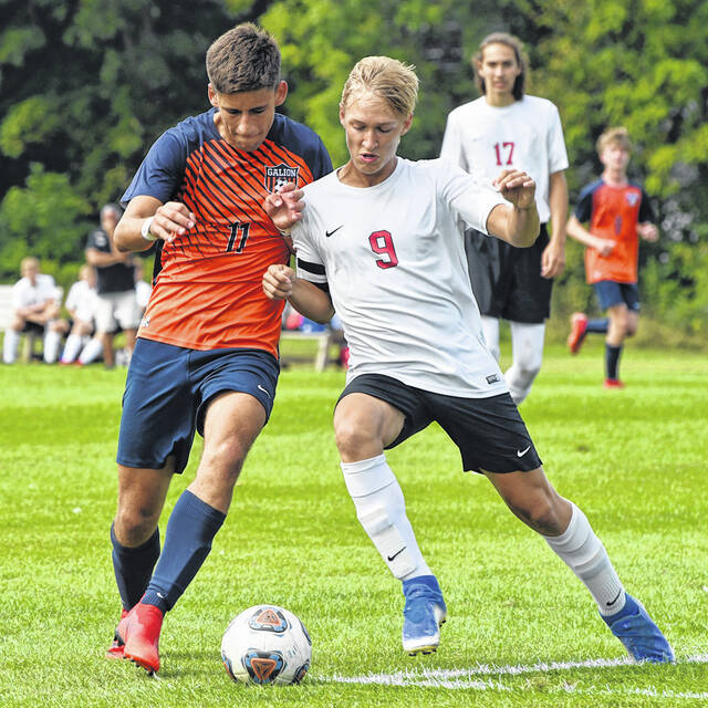 Galion's Walker Frankhouse (11) battles Pleasant's Nicky deWet (9) for possession of the ball during the Tigers 6-0 shutout win against the Spartans on Saturday, Sept. 4, 2021. Frankhouse recorded a hat trick to lead the Tigers to the win at their new soccer complex.