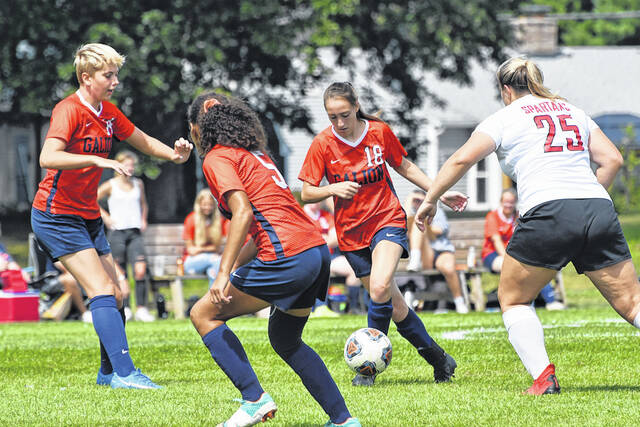 Galion's Autumn Bennett (18) dribbles past Pleasant's Maggie McCall (25) as teammates Tamara Shaw (left) and Mia Felder (5) provide support. Bennett scored one of Galion's two goals in the 3-2 loss to Pleasant on Saturday, Sept. 4, 2021, at the Lady Tigers new home field.