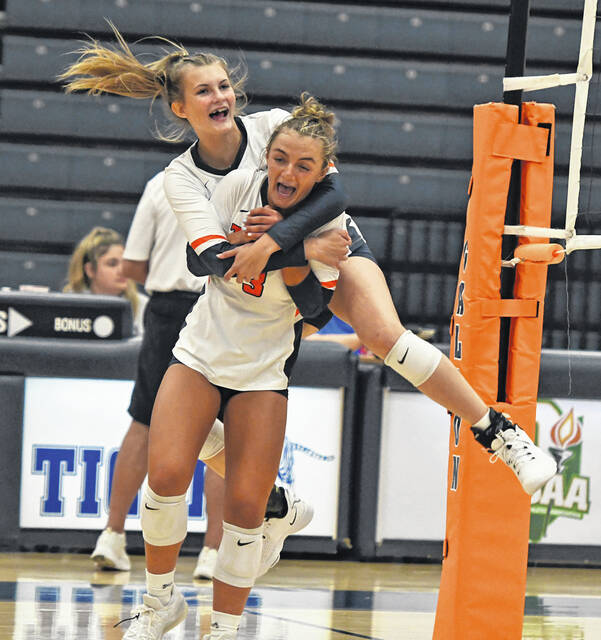 Galion's Hailey Young and Ashley Dyer celebrate a key moment during the Lady Tigers match against Highland on Thursday, Sept. 9, 2021. The Lady Scots prevailed 3-1 to move into a tie with River Valley for first place in the Mid Ohio Athletic Conference. Galion is one match behind the co-leaders in the standings.
