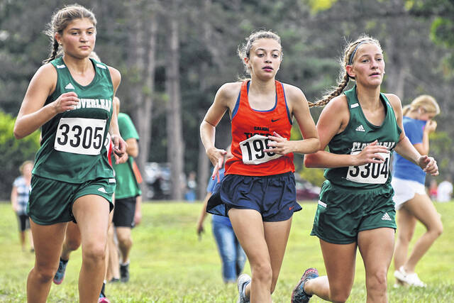 Galion's Raygann Campbell (center) battles for position against two runners from Cloverleaf during the Galion Cross Country Festival on Saturday, Sept. 18, 2021, at Amann Reservoir. Campbell placed 19th in the Division 2 race, posting a time of 20:56.8.