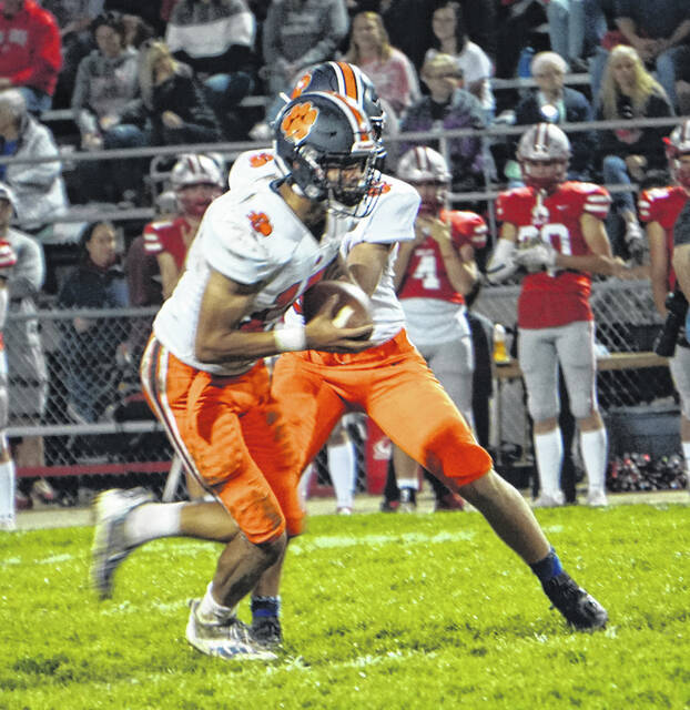 Galion quarterback Cooper Kent hands the ball off to running back Hanif Donaldson during the Tigers' game against Shelby on Friday, Oct. 1, 2021, at Skiles Field. The Whippets won the game, 37-7, handing Galion its third consecutive defeat.