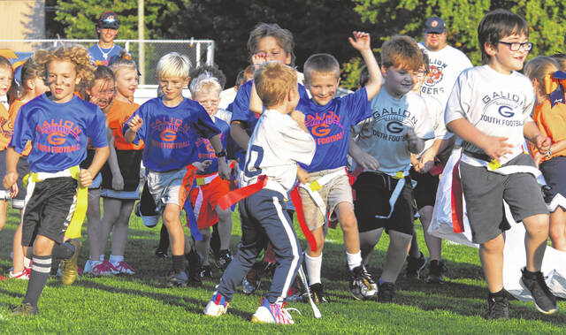 Galion Youth Football players take to the field at Unckrich Stadium on Saturday, Oct. 9, 2021, to participate in championship games. League officials said they plan to make the championship evening and annual event for the players and cheerleaders.