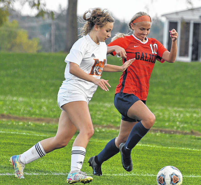 Galion's Nicole Noble battles a Mansfield Senior player for possession of the ball during a match played Tuesday, Oct. 5, 2021. The Tygers won the match 6-0.