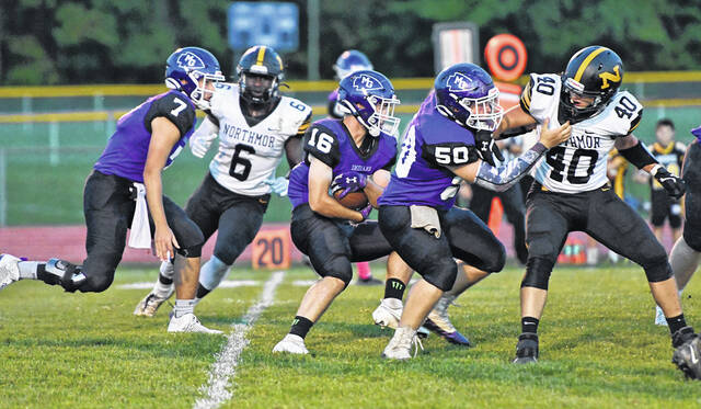 Mount Gilead's Kyan Davis runs against Northmor's defense Friday night. The Golden Knights prevailed 49-16 to stay unbeaten.